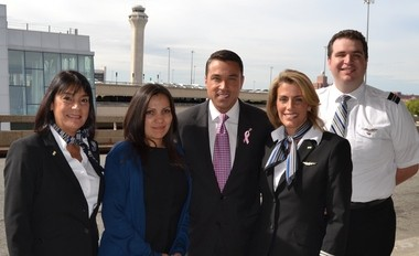 Rep. Michael Grimm, center, with flight attendants and AFA-CWA International President Sara Nelson, second from the right, at Newark Liberty International Airport.