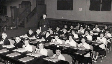 Before construction of the St. Roch school building, students were housed in makeshift classrooms, such as this one in the church hall. Shown here is Mrs. Vitella's fourth-grade class in 1959. (Photo courtesy of St. Roch School.)