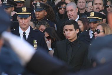 Justin Ramos, 19, exits his father's funeral at Christ Tabernacle Church on Saturday. (Staten Island Advance/Vincent Barone)