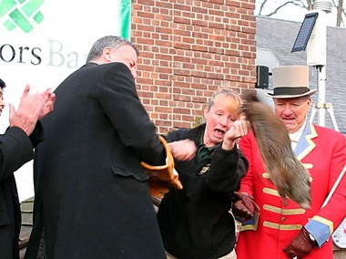Mayor Bill de Blasio, left, winces as Staten Island Chuck breaks free and drops to the stage during the 2014 Groundhog Day ceremony at the Staten Island Zoo.