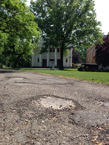 The Snug Harbor Cultural Center & Botanical Garden must pay an outside contractor to repair crumbling roads and walkways on the expansive grounds. (Staten Island Advance/ Jan Somma-Hammel)