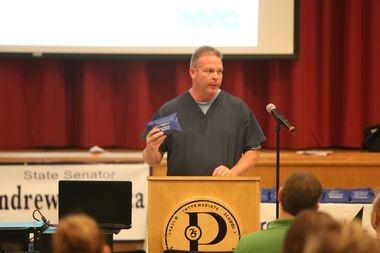 Kevin Keeley demonstrates how to properly use a naloxone kit. (Staten Island Advance/Ryan Lavis)
