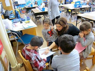 PS 5 Principal Lisa Arcuri visits a kindergarten class at the Huguenot school, which was named a national Blue Ribbon School of Excellence for sustained achievement in mathand English language arts. (Photo courtesy PS 5)