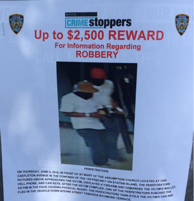 This NYPD flier displayed on the corner of Castleton Avenue and Bodine Street, shows two men sought for questioning in the robbery.