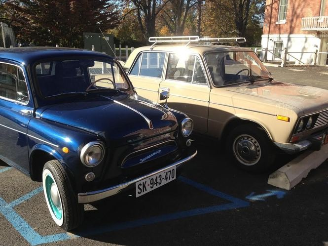 "Two other vintage cars used for cameo appearances in ""The Americans"" sit in the parking lot at Snug Harbor. At left is a dark blue 1966 ZAZ and at right is a beige 1988 Lada. (Staten Island Advance/Claire Regan)"