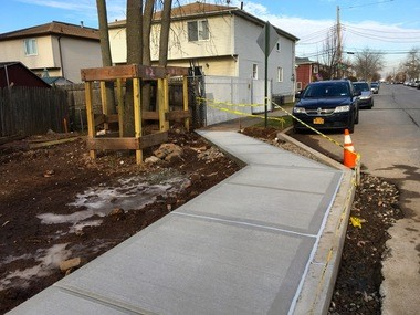 A sidewalk created alongside a new house in Mariners Harbor juts out farther in the street than the adjacent sidewalk. (Staten Island Advance/Rachel Shapiro)