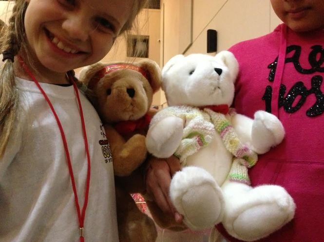 Cuddly bears bring smiles to the faces of Camp Good Grief campers. (Staten Island Advance/Claire Regan)