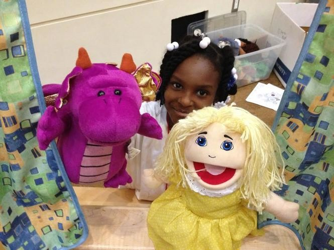 A young camper uses puppets during the Camp Good Grief weekend at the JCC. (Staten Island Advance/Claire Regan)