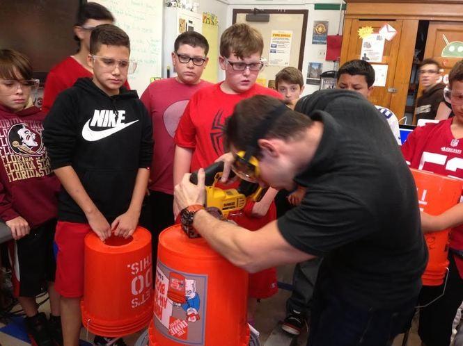 Students watch as Totten's STEM teacher Michael Russo prepares a toroidal vortex cannon. (Staten Island Advance/Claire Regan)