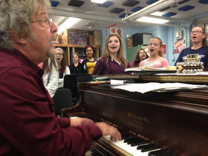 Steven Blaine leads the seventh-grade chorus in a rehearsal for a Totten Intermediate School concert. (Staten Island Advance/Claire Regan)