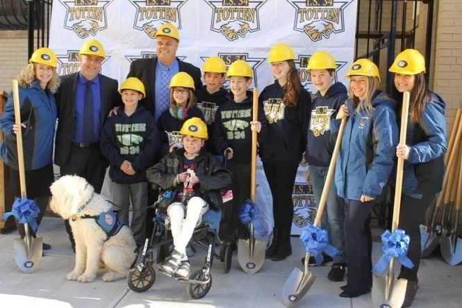 John Hudson Dilgen, who graduated from Totten Intermediate last June, joins school and DOE officials at a groundbreaking ceremony for the accessibility upgrade project. (Photo courtesy of Totten Intermediate School)