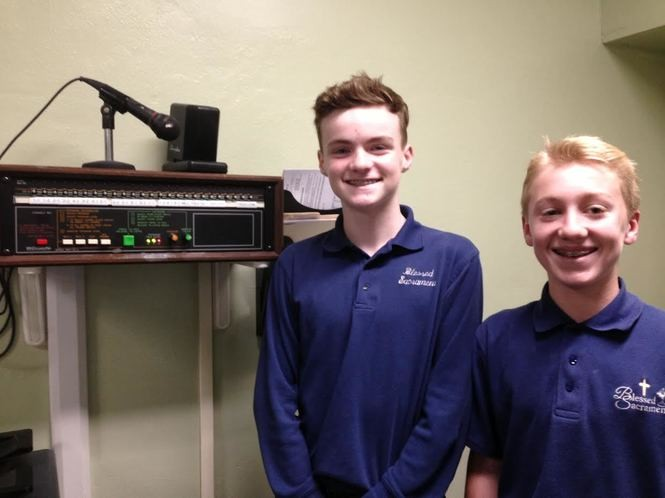 Thirteen-year-old eighth-graders William McNeely and Sean Keag are ready to recite a prayer through the public address system. McNeely will attend Xaverian High School, Brooklyn, in the fall while Keag heads to Monsignor Farrell High School, Oakwood. (Staten Island Advance/Claire Regan)