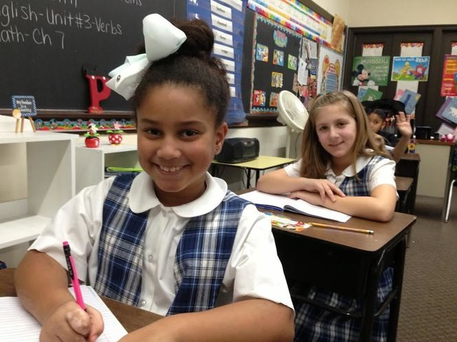 Elizabeth Agboton and Lauren Scollan are students in Stacey Porazzo's third-grade class at Blessed Sacrament School. (Staten Island Advance/Claire Regan)