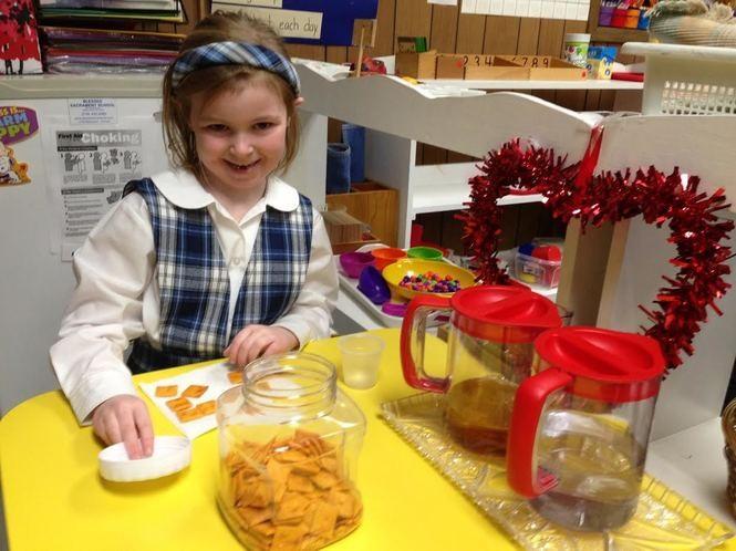 Blessed Sacrament kindergartner Colleen Ferguson sorts snacks in the classroom. (Staten Island Advance/Claire Regan)