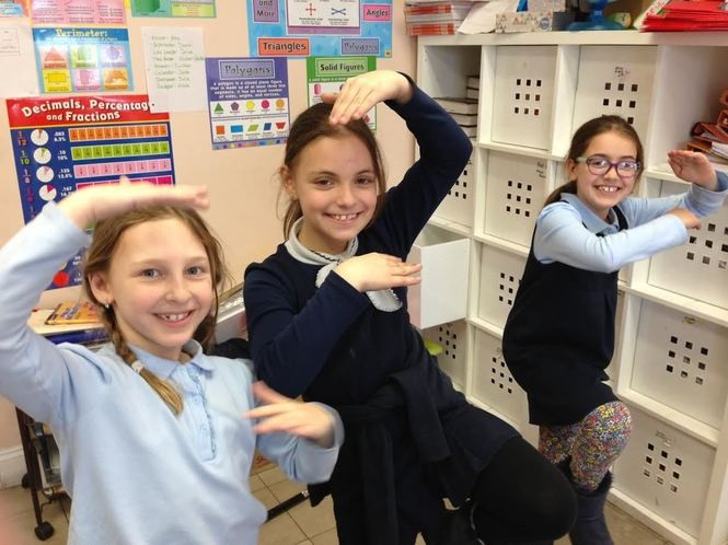 Third-graders Isabelle Shtaynberg, Anna Gershkovich and Abigail Bezvevsky have some fun as dismissal time nears at Staten Island Hebrew Academy. (Staten Island Advance/Claire Regan)