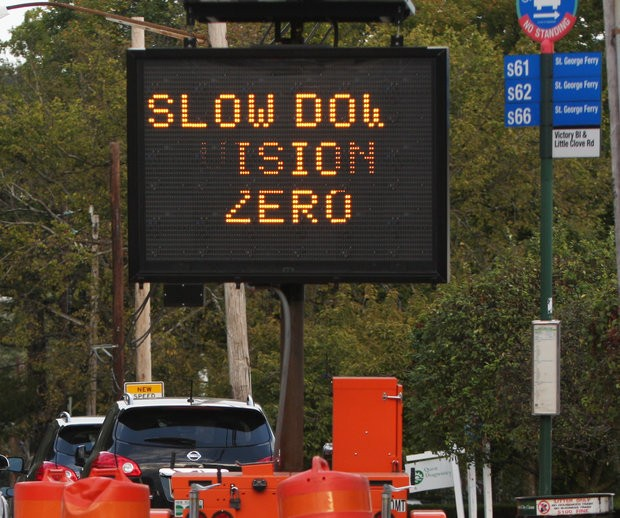 Vision Zero flashing sign advising drivers to slow down. The Health Department released a report on dangerous driving behaviors of adults and teenagers in New York City. (Staten Island Advance/Hilton Flores)