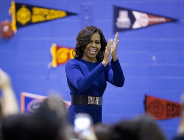 Former First Lady Michelle Obama is urging high school seniors to post their college plans on social media for national College Signing Day Friday. (Associated Press)
