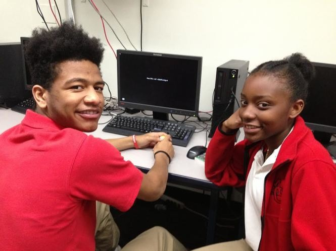 Bryan Sanon and Kamaria Hyde, sophomores at Moore Catholic, work together in sociology class. (Staten Island Advance/Claire Regan)