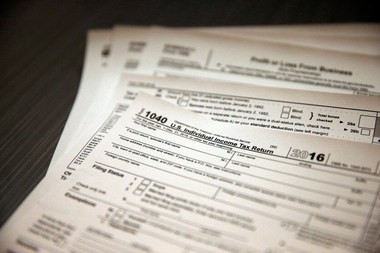 IRS revenue officer James C. Brewer admitted to falsifying tax returns and lying about it to the government, said officials. (AP Photo/Brennan Linsley)