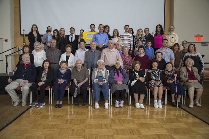 Holocaust survivors and their families at the Cafe Europa event at the Jewish Community Center of Staten Island. (Staten Island Advance/Shira Stoll)