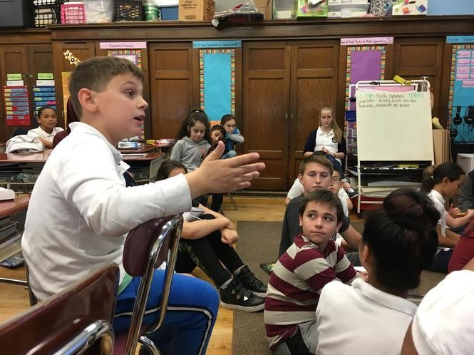 PS 39 fifth-grader Daniel Guz makes a point during class. (Staten Island Advance/Claire Regan)