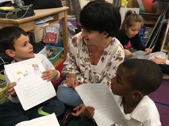 Drama teacher Dawn Macchia works with kindergartners Edis Borici, left, and Mason Arroyo. (Staten Island Advance/Claire Regan)