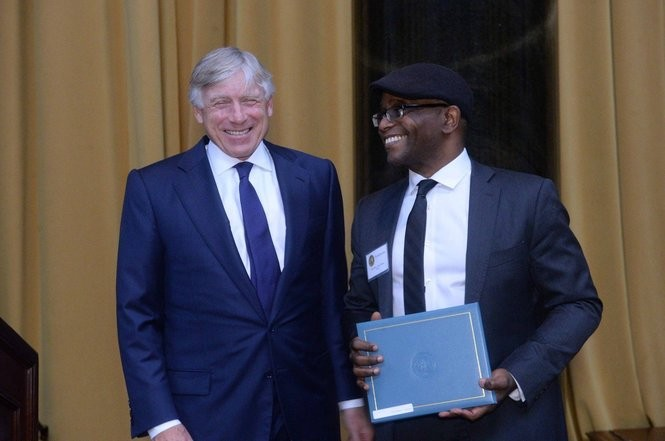 A professor of English at the College of Staten Island since 2009, Tyehimba Jess accepts the Pulitzer Prize last May from Columbia University President Lee C. Bollinger. (Photo courtesy of pulitzer.org)