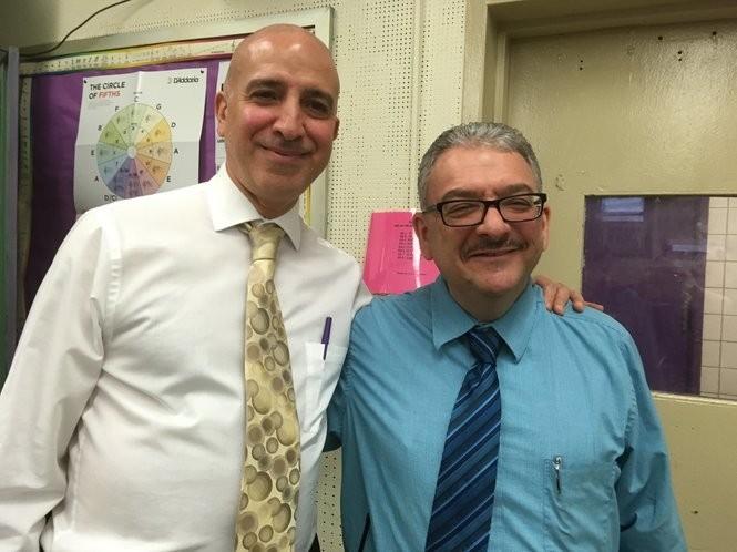 Joseph Scarmato, left, principal of Tottenville High School since 2014, visits with David LaMorte, assistant principal for the performing arts. (Staten Island Advance/Claire Regan)