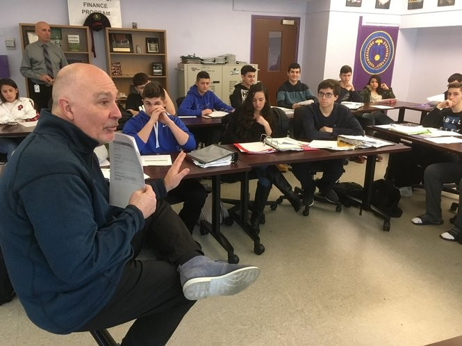 Steven Saliski lectures about retirement planning during a finance class at Tottenville High School. (Staten Island Advance/Claire Regan)