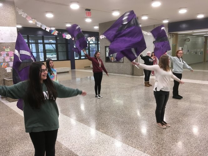 Members of the marching band color guard rehearse in the Tottenville High School lobby. (Staten Island Advance/Claire Regan)