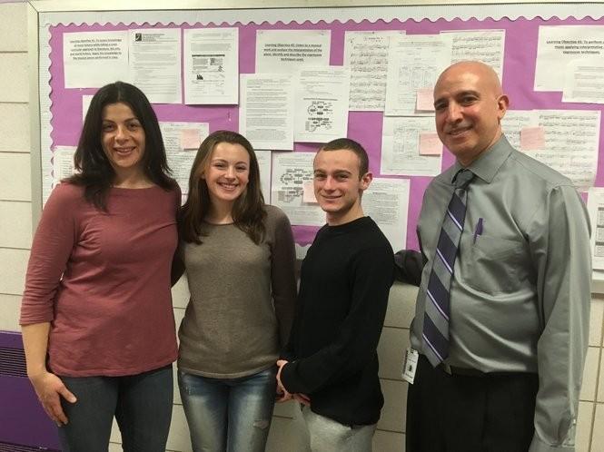 Music teacher Elizabeth Schubert, left, and Principal Joseph Scarmato, right, join students Danielle Cianciotto and Thomas Zapata outside music class. (Staten Island Advance/Claire Regan)