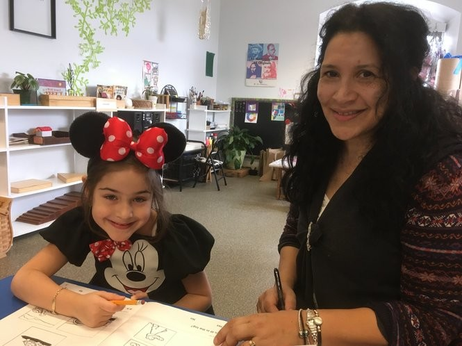 Pauline Velez-Romano, teacher and art consultant, works with 5-year-old Belinay Uyug. (Staten Island Advance/Claire Regan)