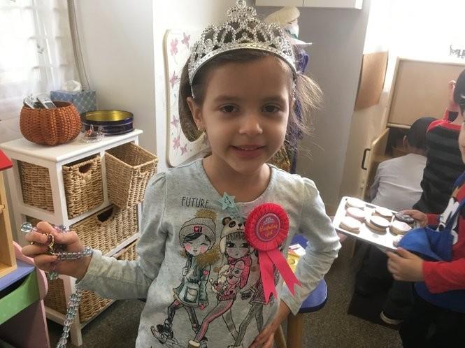 Victoria Cella, 4, accessorizes in her classroom at Children's Harbor Montessori School. (Staten Island Advance/Claire Regan)