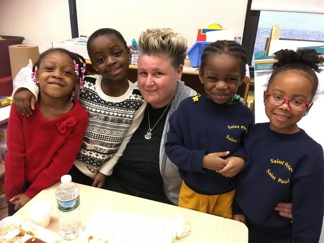 Teacher Sandra Stropkai is joined by her pre-K students, from left, Arielle Sesay, Rosetta Saah, Joy Emuchay and Alexandria Tassy. (Staten Island Advance/Claire Regan)