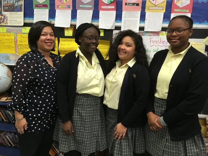 Principal Jennifer Olivera is joined by eighth-graders Arianna Prempeh, Leidy Rodriguez and Shayla George. (Staten Island Advance/Claire Regan)