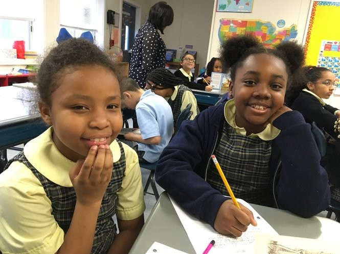 Edna Williams and Chamille Rhymes are third-grade friends at St. Peter-St. Paul School. (Staten Island Advance/Claire Regan)