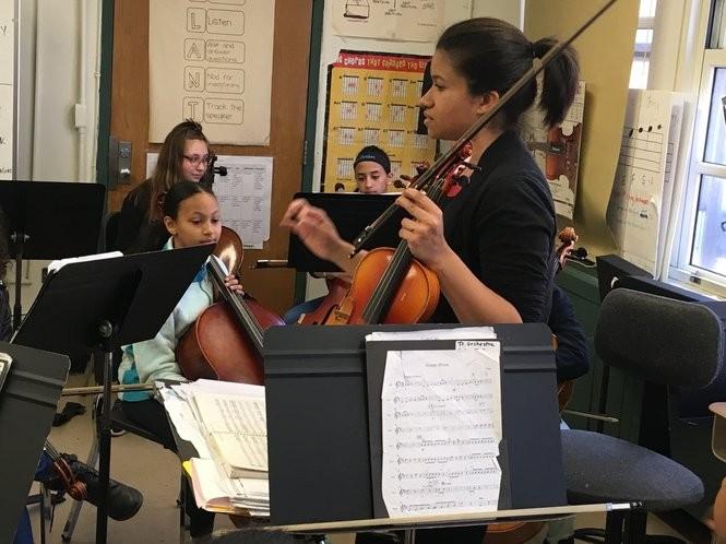 Teacher Carmen Elias coaches students in a strings talent class. (Staten Island Advance/Claire Regan)