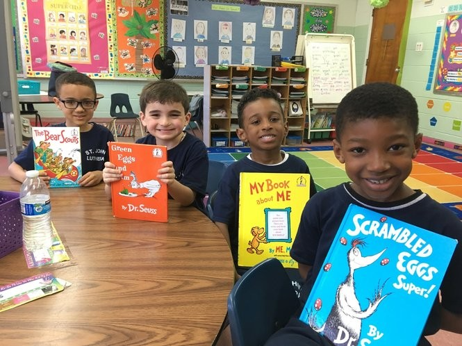Jonathan Colon, left, Jude Walters, Fabian Lewis and Ogechi Onyenwe are ready to read Dr. Seuss books in their kindergarten classroom. (Staten Island Advance/Claire Regan)