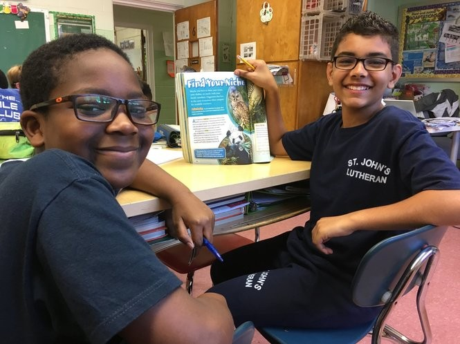 Advertus Clinton and Luis Quiles enjoy fifth-grade science class at St. John's Lutheran School. (Staten Island Advance/Claire Regan)
