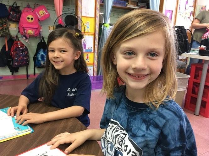 Kindergartners Frida Cifra-Halberg and Luke Salomone enjoy reading at St. John's Lutheran School, Castleton Corners. (Staten Island Advance/Claire Regan)