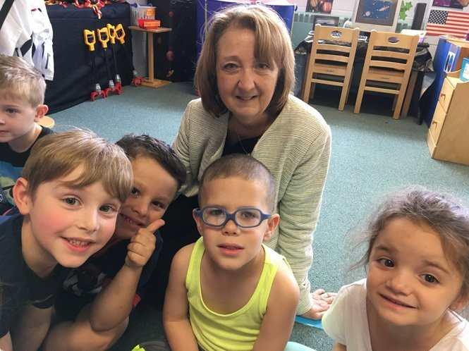 Betty Jane Bullen, executive director of the preschool, joins 4-year-olds in their classroom. From left are Leo Addessi, Jax Lestingi, Christian Ferraioli and Sophia Sfouggatakis. (Staten Island Advance/Claire Regan)