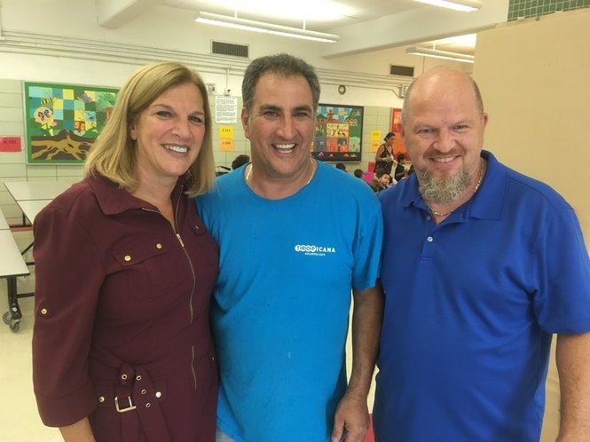 Principal Jane McCord joins Robert Privitera, center, and Tom Maddocks of the PS 52 custodial staff. (Staten Island Advance/Claire Regan)