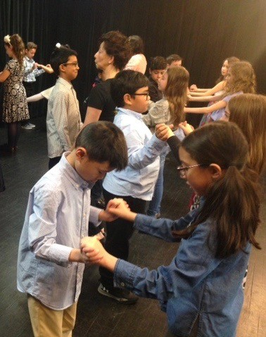 Fourth-graders at PS 54, Willowbrook, have been working with a professional dancer with Sundog Theatre Company to learn ballroom dancing. (Photo courtesy of Denise Dicks)