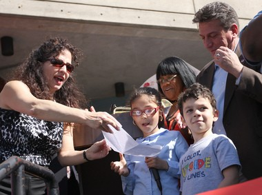 State Sen. Diane Savino, left, helps as Ju-Lissa Jensen, 11, and her brother, Michael, 5, speak out about losing their after-school program at PS 57 in Clifton during a rally on May 17, 2012.