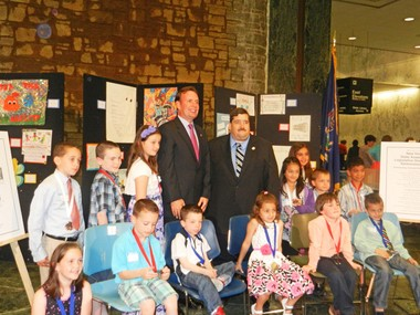 State Assemblyman Michael Cusick (D-Mid-Island), center left, former chairman of the Assembly Task Force on People with Disabilities, and current task force chairman, Assemblyman Michael Miller, are pictured with Staten Island students who won Assemblyman Cusick's poster contest, 'What Disability Means to Me.' The day-long event took place in Albany. Photo Courtesy of Office of State Assemblyman Michael Cusick