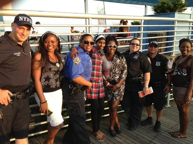 Members of the NYPD on patrol at the South Beach boardwalk take a moment to pose with African fellows from Wagner College. (Claire Regan/Staten Island Advance)