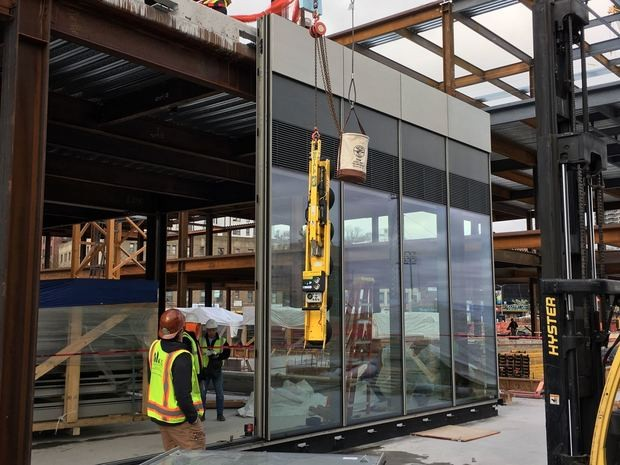 The first panels of the facade of Nordstorm Rack -- one of the anchors of Empire Outlets -- were erected on Wednesday, according to the project's developer. (Courtesy of Joseph Ferrara)
