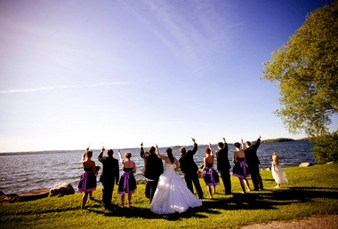 Jennifer Cassista and Tom Bryan, center, celebrate with members of their bridal party during their wedding at the Golden Beach Resort, near Toronto, a venue the couple secured for their nuptials at the last minute after the first venue they had selected went bankrupt.