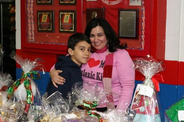 "Wendy Ramos, founder of Wishes of Literacy, poses with her son, Luis, who has a ""severe"" case of dyslexia."