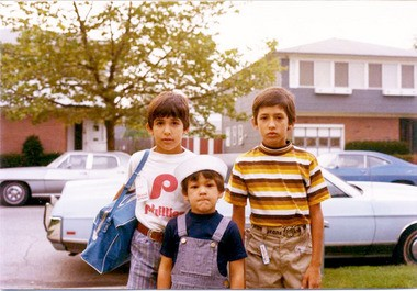 In this 1977 photo, David Bamundo, left, poses with his older brother, Vincent, right, and Paul, the baby of the family, outside their home in New Springville. Because David eventually became the tallest of the three siblings, people sometimes would mistake him as the eldest.